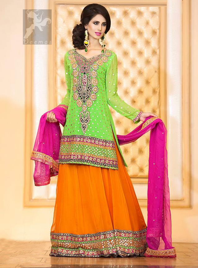 Best Dress for Mehndi having Bright Green Shirt With Orange Lehenga and Shocking Pink Dupatta
