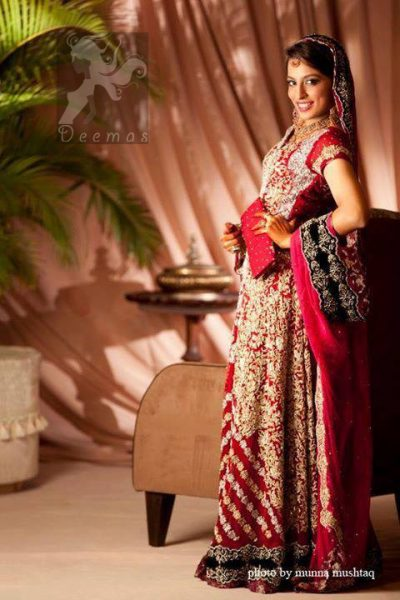 This bridal stands out due to its uniqueness and the perfect fusion of modern cut and traditional embroidery. Deep red pure chiffon front open gown features stunning embellishment all over the front. This super stunning shirt is made of rich floral embroidery which is further enhanced with zardoze work. Hemline is decorated with embroidered black applique and banarsi patch at the end. Matching deep red dupatta. Dupatta contains embroidered border on four side edge and lighter work on the ground.