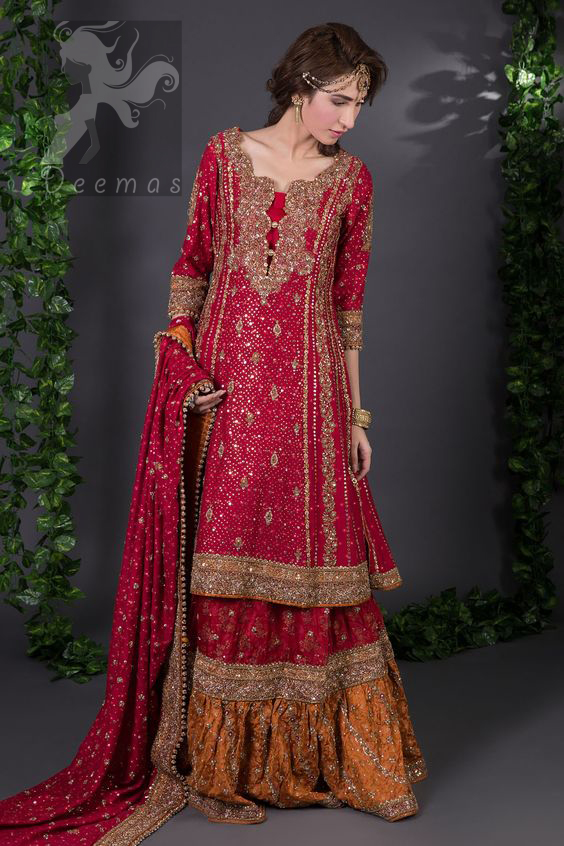 Crimson A-line slits shirt adorned with beautiful neckline, stripes and hemline. Matching dupatta having embellished border on four sides, sequence and small motifs spray all over it. Lehenga in Crimson and Copper having embellished Gott like gharara (below the knee), stripes and small motifs spray. Embellishment in light and dark antique shades.