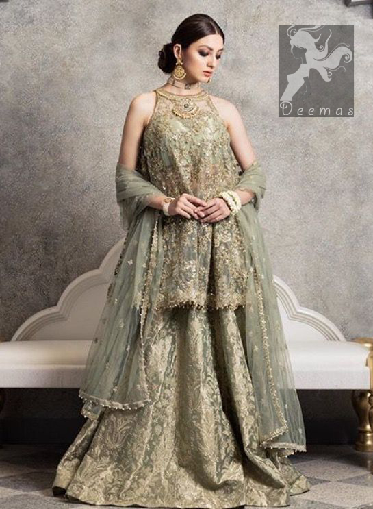 Sage net peplum having halter neck design. Peplum adorned with mix embellishment. Sage brocade plain lehenga. Sage net dupatta finished with piping and having pearls on the sides.