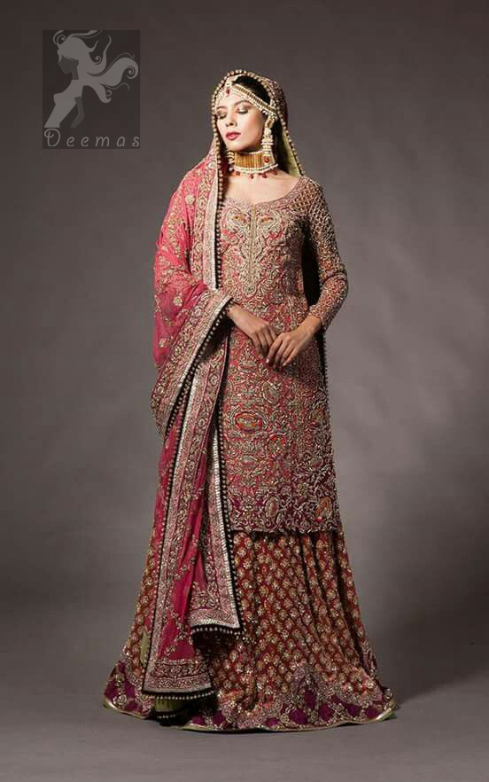 Tea rose fully embellished shirt with plum applique border on hemline. Plum dupatta adorned with tea rose and silver appliques having black finishing. Tea rose fully embellished lehenga with small motifs having plum applique border on hemline.