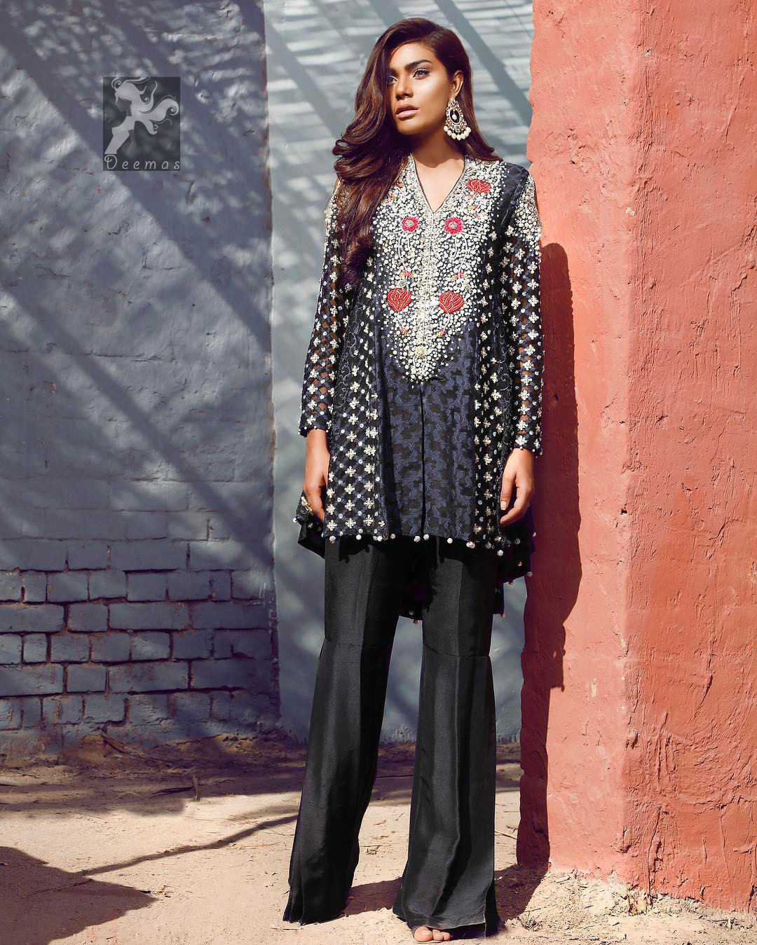 Black peplum made with pure banarsi jamawar chiffon. Peplum having multiple panels of different banarsi patterns. White and silver embellishment on neckline, side panels and sleeves.