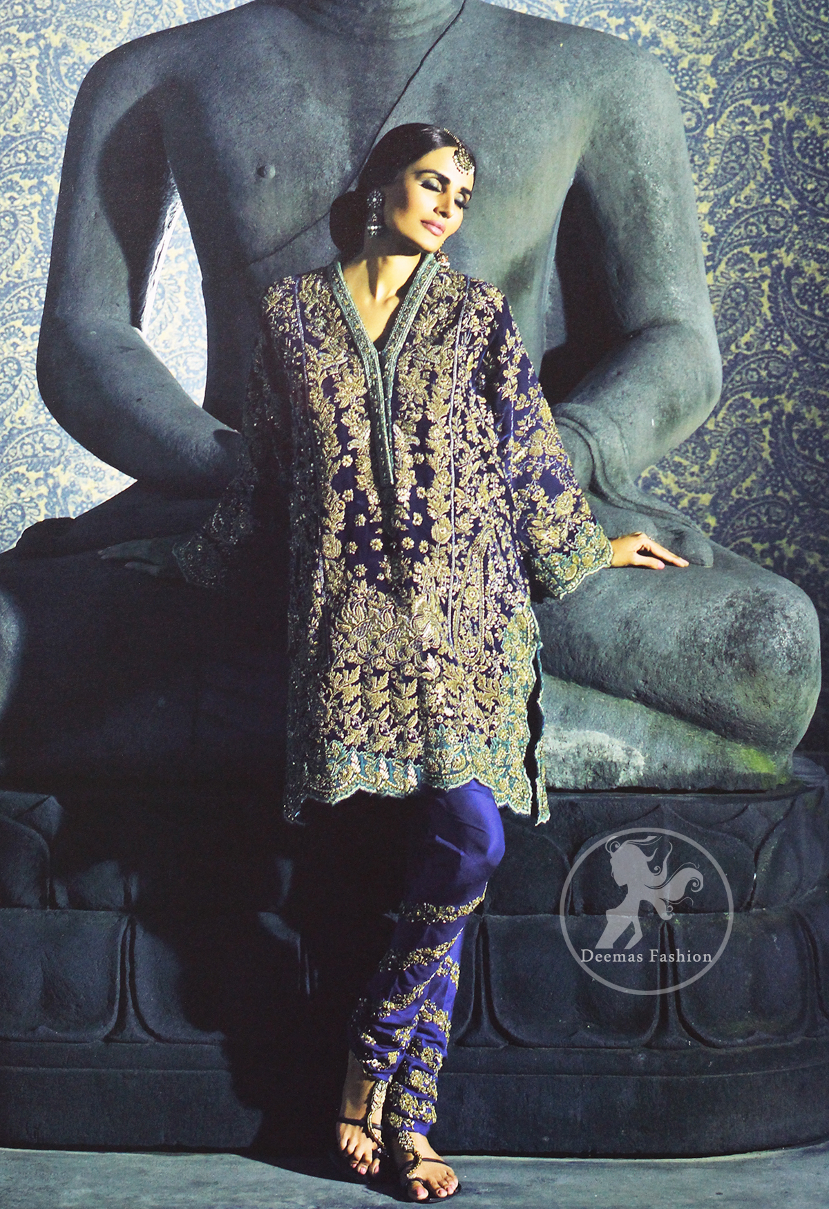 This classic shirt is reflecting exuberant colours. Kurta style shirt meticulously highlighted with antique kora, dabka, pearls and sequins. It has silhouettes adorned with neckline. This shirt is decorated with front and back panels having gorgeous floral embroidery. Shirt is fully scalloped, artfully coordinated with delicate embroidered pajama. It comes with chiffon dupatta decorated with sequins spray all over.