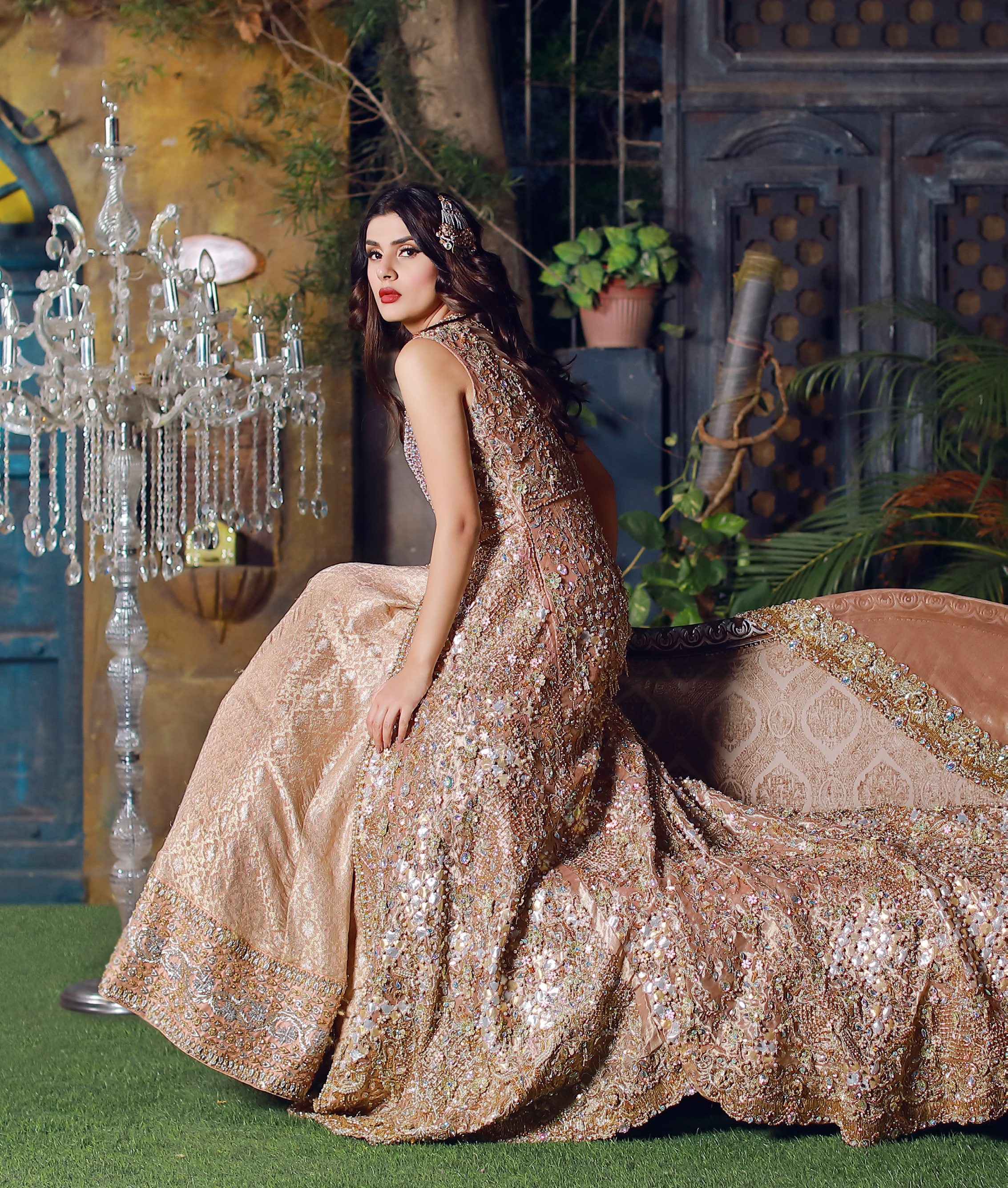 This dress is beautifully sculptured with floral embroidery. It is meticulously highlighted with silver kora, dabka, tilla, sequins and pearls. Back is fully embroidered. Trail is magnificently decorated with scalloped border. Beautiful bodice adds to the look. Inner of this trail is of brocade which has thick embellished border. Complete the look with embellished dupatta.