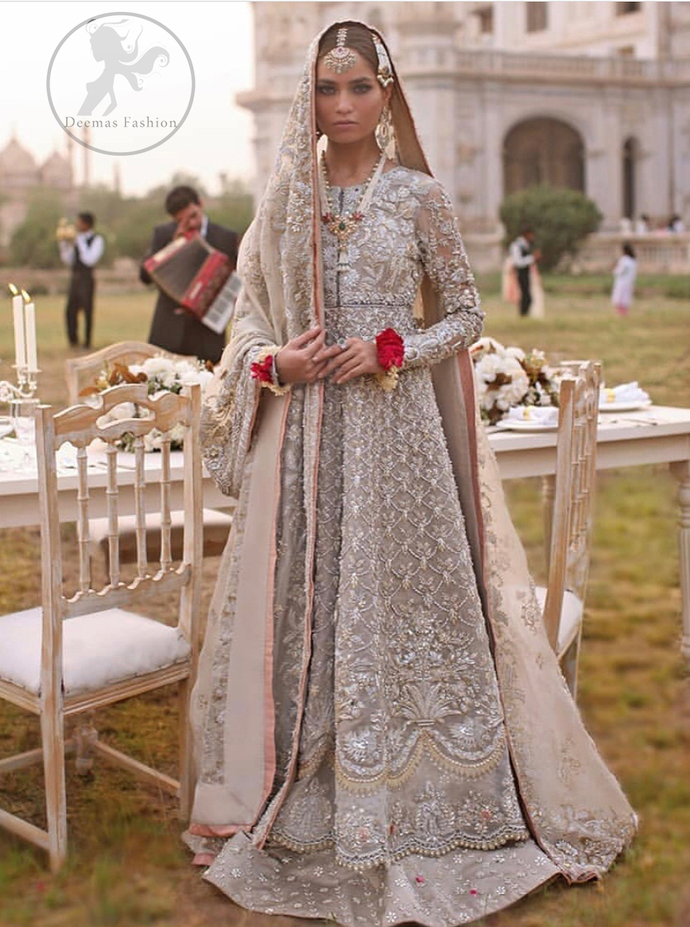 This outfit is a timeless beauty.It is heavily embellished with silver gold kora dabka, Sequins and swaronski crystals.This exquisite Pishwas is fully decorated with floral motifs patterns all over it.It is further enhanced with Foral thread embroidery.The trimming border of pishwas is ornamented with small golden pearls. It comes with embellished lehengha which has small sized sprinkled floral motifs all over.This Outfit is beautifully coordinated with matching Dupatta with heavy embroidered borders.