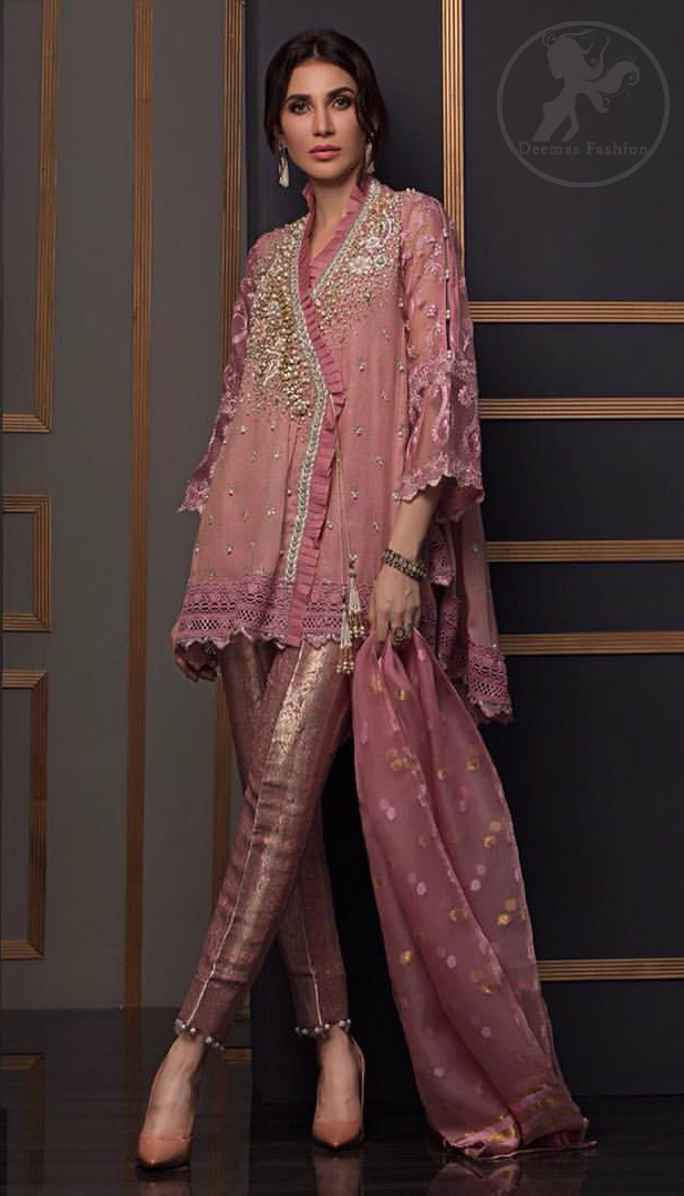 This outstanding angrakha style shirt meticulously highlighted with dull golden and antique shaded kora, dabka , tilla, sequins and pearls. This dress is beautifully adorned with floral embroidery. Sleeves are decorated with resham embroidery which adds to the look. It comes with brocade pajama. It is beautifully coordinated with chiffon dupatta having sprinkled sequins all over it.