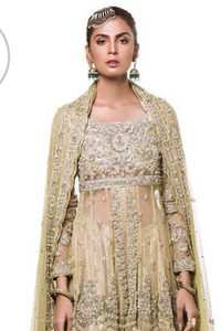 This dress is beautifully sculptured with floral embroidery. It is meticulously highlighted with antique shaded kora, dabka, tilla, sequins and pearls. It is embellished with beautiful tassels which adds to the look. It is artistically paired up with gharara which comprises of floral thread colourful motifs. It comes with chiffon dupatta which has four sided embellished borders and sprinkled with small sized sequins motifs all over it.