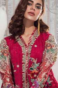 This outfit is embellished with resham thread. It is meticulously highlighted with kora dabka tilla sequins and pearls. Sleeves are adorned with floral embroidery. V-shaped neckline adds to the look. Hemline is allured with beautiful tassels. It comes with shocking pink pants pajama.It is coordinated with chiffon dupatta which is sprinkled with sequins all over.