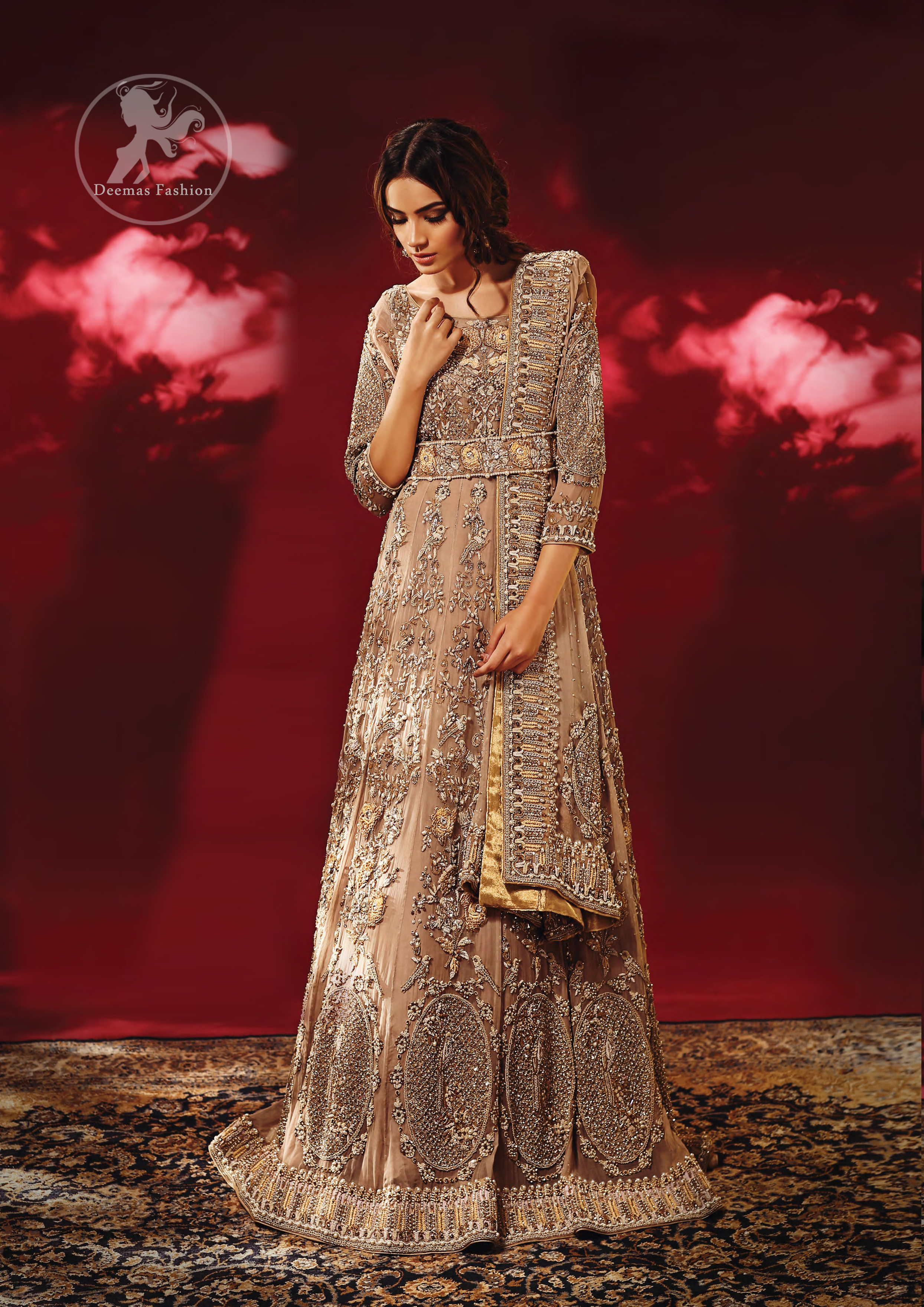 Redefine your style in this traditional and versatile ensemble ornamented with floral and geometric embroidery furnished with antique shaded kora dabka kundan and pearls. It comes with brocade cigarette pants. It is stunningly coordinated with antique brass dupatta with embellished borders on all sides and sequins spray all over.