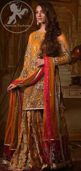 This exquisite shirt is fully decorated with floral and different motifs patterns all over it. This dress is beautifully decorated with heavy embroidery. It is highlighted with kora, dabka, tilla, sequins and pearls. Lehengha is fully embellished with tilla work. It is artistically coordinated with net dupatta which is embellished.