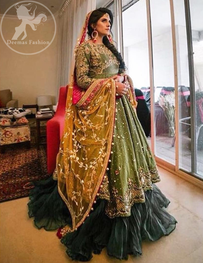 This exquisite large flared frock is fully decorated with floral and different motifs patterns all over it. It is highlighted with kora, dabka, tilla, sequins and pearls. It is adorned with beautiful frock. It is artistically coordinated with chiffon dupatta decorated with one sided matha patti style embroidery and floral pattern all over it. It comes with lehengha.