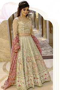 This dress is adorned with floral embroidery, highlighted with kora, dabka, tilla, sequins and pearls. It is allured with intricate embroidered motifs and detailed bodice. Blouse is scalloped. The border on hemline is enhanced with embellished floral pattern detailing, that instantly draws attention.It comes with embellished net lehengha with brocade lining. It is artistically coordinated with net dupatta which is allured with four sided border.