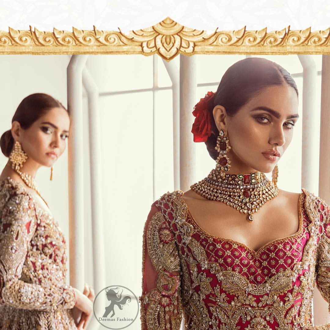 This bridal dress is perfect for your special day. Beautifully decorated with floral embroidery and embellished scalloped border. It is adorned with kora, dabka, tilla, sequins and pearls. It comes with an exquisite lehengha with thick embroidered border to give it a regal look. Dupatta comprises of floral thread embroidery allured with thick embellished border.