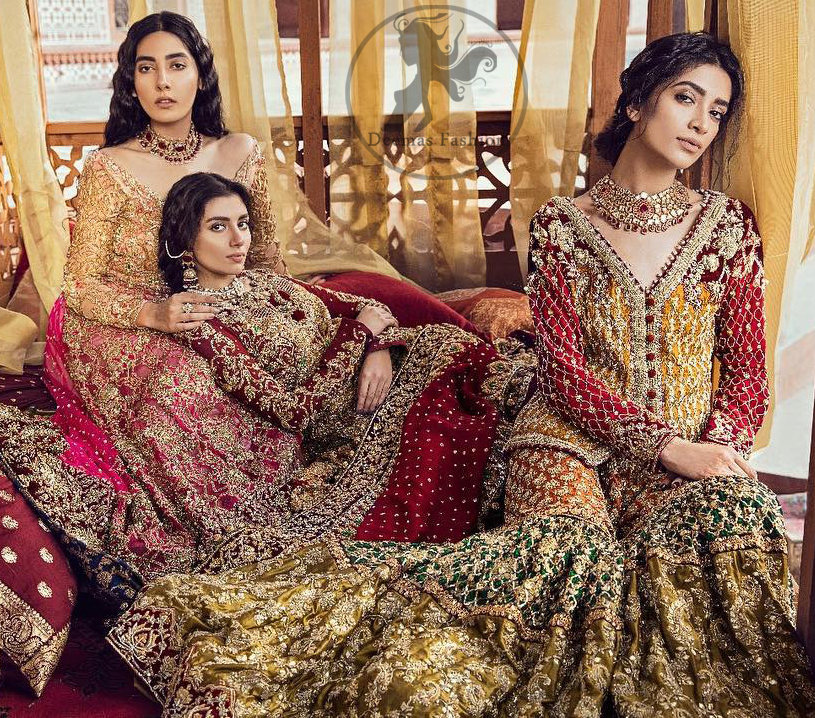 The grand gold bridal stands out due to its uniqueness and the perfect fusion of modern cut and traditional embroidery. This dress is beautifully decorated with heavy embroidery. It is highlighted with kora, dabka, tilla, sequins and pearls. It comes with heavy embroidered gharara. It is coordinated with chiffon dupatta which is sprinkled with sequins all over it. It is allured with four sided embellished borderand beautiful tassels adds to the look.