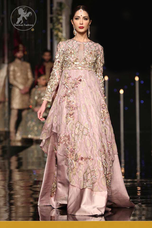 The fusion of unique crafting and a soothing palette lends exquisite elegance and minimalistic sobriety to your opulent evening wear done with light gold kora dabka, kundan and sequins work. It is further enhanced with tilla and sequined geometric embroidery all over. Having full length sleeves and handcrafted belt and fully embellished from back.