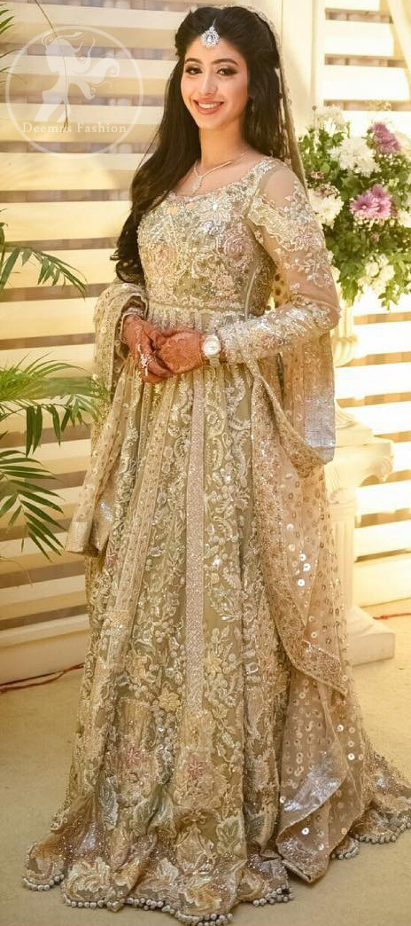 This outfit is a timeless beauty. Feel glamorous in our multiple paneled maxi with fascinating embellishment on neckline with silver kora dabka, pearl and sequins. Sleeves are decorated in victorial styles embroidery. It comes with brocade trouser. It is coordinated with tissue dupatta which is sprinkled with sequins all over it. It is further furnished with four sided embellished border.