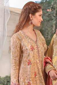 This super stunning back trail shirt is made of rich floral embroidery which is further enhanced with zerdosi work. It is finished with scalloped embellished border all around the shirt. Back of the shirt is decorated with small sized sprinkled motifs all over. The outfit is coordinated with shocking pink & pale green traditional gharara.