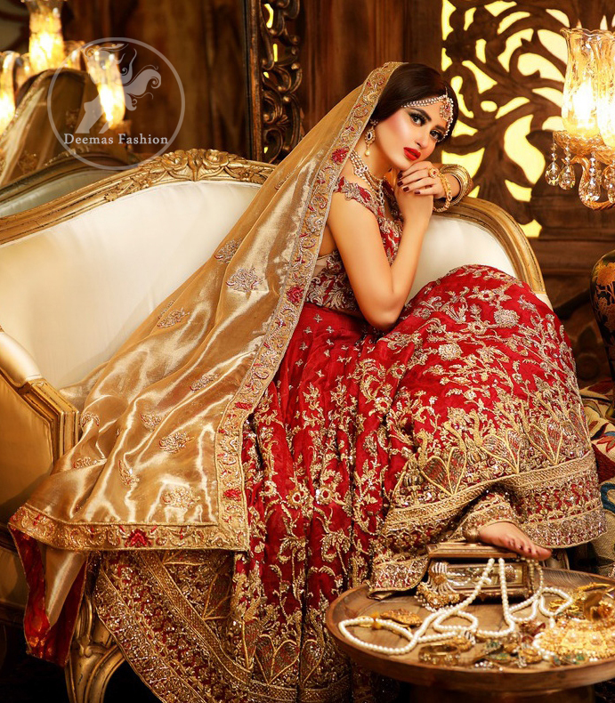 Reflecting royalty and the majestic beauty of statuesque shape and silhouette this bridal dress is perfect for your special day. Feel glamorous in this floor length maxi with fascinating embellishment around the neckline with golden kora dabka, pearls and sequins. It is further enhanced with floral motifs and heavy embroidered bottom. The hemline is decorated with heart shape motifs all around the bottom of maxi. It comprises with brocade pajama and golden dupatta having four sided embroidered borders and sprinkled small motifs on ground.