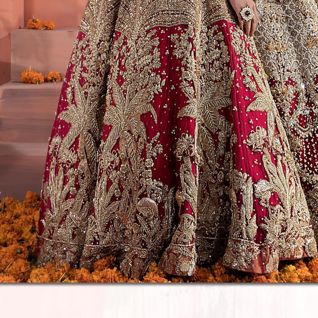 The bridal stands out due to its uniqueness and the perfect fusion of modern cut and traditional embroidery. This dress is beautifully decorated with heavy embroidery. It is highlighted with kora, dabka, tilla, sequins and pearls. It comes with embroidered sharara. It is coordinated with tissue dupatta which is sprinkled with sequins all over it. It is further furnished with four sided scalloped border.