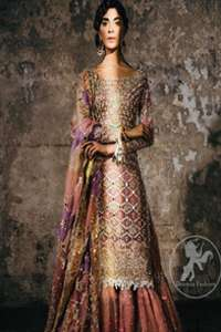 This bridal dress stands out due to its uniqueness and the perfect fusion of modern cut and traditional embroidery. It is enhanced with kora, dabka, tilla, gota, sequins and pearls. Shirt is fully embellished in crisscross pattern. It is artistically coordinated with tissue gharara which is adorned with colourful motifs and colourful embroidered dupatta detailed with gold gota work and finishing adds to the look.