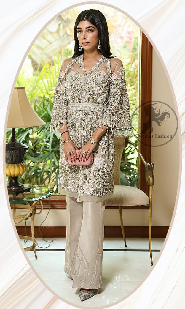 Create a vision of elegance with this front open shirt decorated with intricate floral embroidery detailing and silver kora, dabka and sequins. It is further enhanced with embellished fixed waist belt. Third quarter bell sleeves are adorned with floral embroidery and zardosi work, finishing with tassels at the end. This outfit paired up with raw silk bell bottom. It is coordinated with tissue dupatta which is sprinkled with sequins all over it.