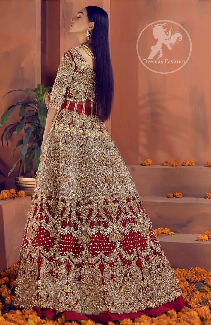 Reflecting royalty and the majestic beauty of statuesque shape and silhouette this bridal dress is perfect for your special day. This traditional outfit is aesthetically designed with motifs and floral patterns, embellished with kora, dabka, nakshi, sequins, crystals and stones. The back of the maxi also adorned with floral motifs in kora, dabka with sequin spray all over. It comes with brocade pajama. It ispaired with heavily embroidered organza dupatta that gives the right amount of glamour to the outfit.