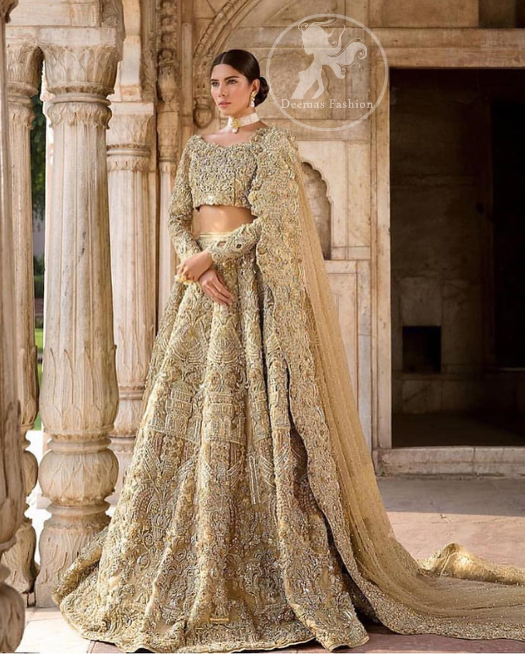 The grand gold bridal stands out due to its uniqueness and the perfect fusion of modern cut and traditional embroidery. This outfit is made of rich floral embroidery and different styles motifs which is further enhanced with zardoze work. It is highlighted with kora, dabka, tilla, sequins and pearls. Heavily embellished lehnga with embroidered motifs spread all over and finished with thick kora and dabka borders completes the look. It is coordinated with beautiful dupatta with thick matha patti border on the front and intricate beautiful border on all rest of the three sides. Furthermore it is enhanced with sprinkled sequins all over it.