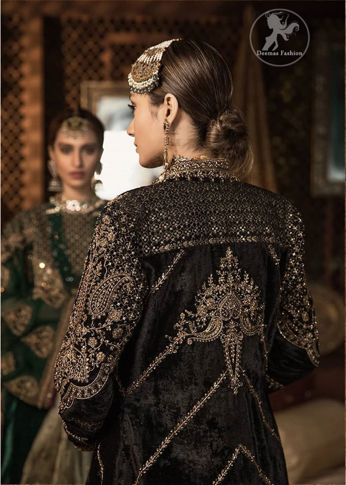 Steal the moment with our rangoon green gown emphasized with traditional and intricate floral embroidery enhanced with antique shaded kora, dabka, tilla and sequins. Perfected with antique gold embellishments this black velvet ensemble is timeless masterpiece in to a chic fantasy. It is fully decorated with antique shaded embroidery and floral motifs all over. Bottom is enhanced with bottle green velvet patch. paired up with floor length dark tan inner. It is coordinated with chiffon dupatta which is sprinkled with sequins all over it.