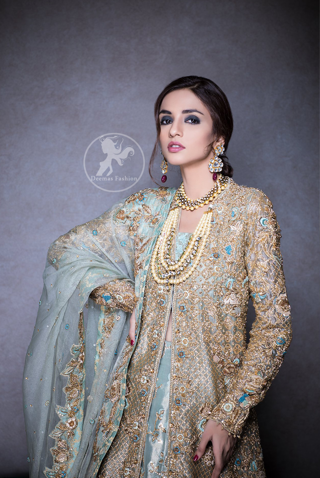 This regal regent gray outfit is an immensely captivating traditional piece, enhancing the art of classical heritage showcasing the craftsmanship of kora, dabka & mukesh detailed with pearls; artistically embellished to give a beautiful rhythm to the outfit. Gown is heavily embellished with antique zardosi work and floral thread embroidery. It comes with embellished lehenga enhanced with embroidered applique on the bottom. It comes with organza dupatta with embellished scalloped border at all ends.