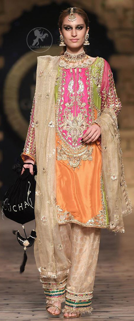This dress is perfect for party wear due to its uniqueness and the perfect fusion of modern cut and traditional embroidery. It is beautifully decorated with heavy embroidery and the shirt is enhanced with embellished applique of two different colors. It is highlighted with kora, dabka, tilla, sequins and pearls. It comes with self printed shalwar which is enhanced with laces on bottom. It is coordinated with tissue dupatta which is sprinkled with small floral motifs all over it. It is further allured with laces all around the edges.