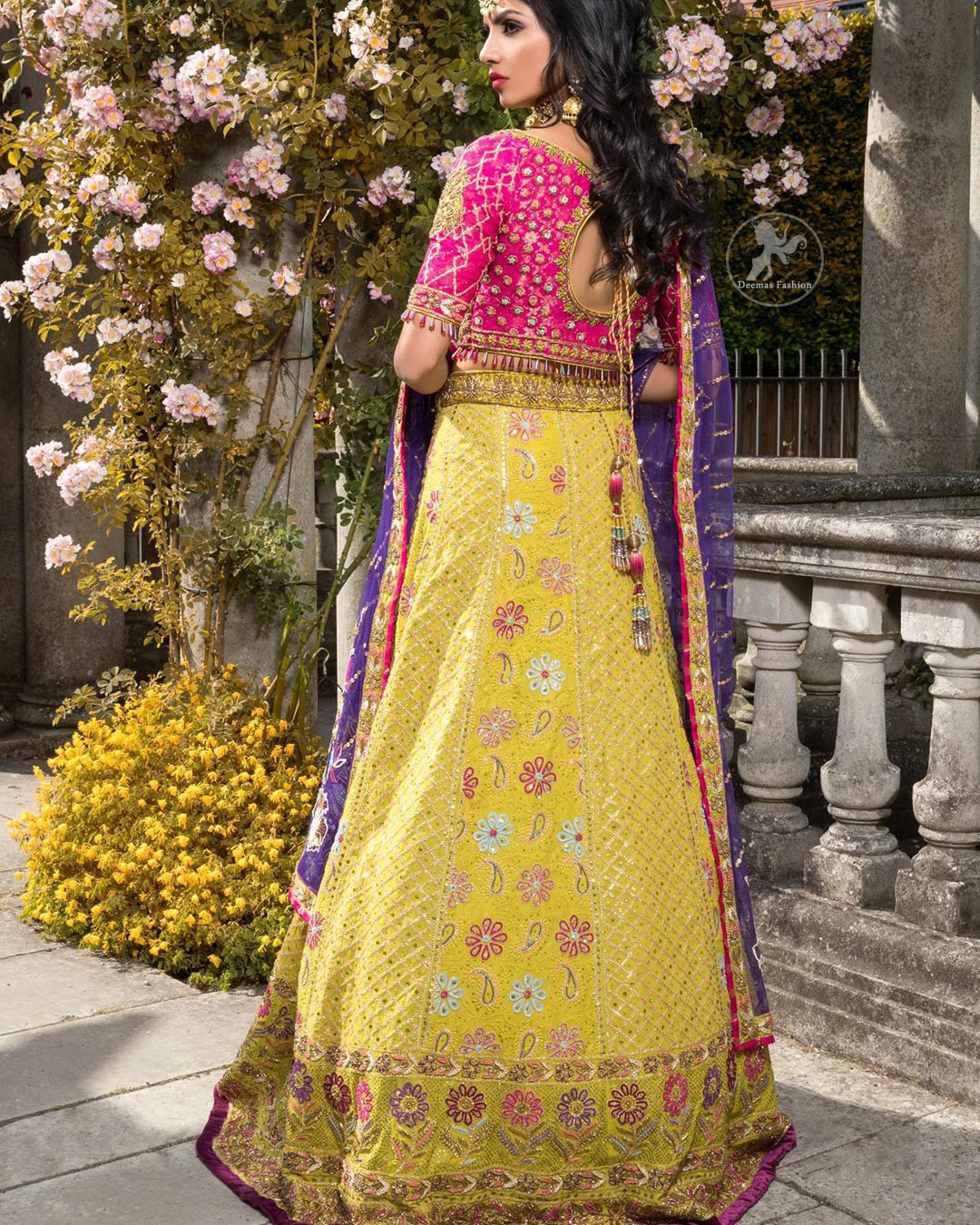 This dress is perfect for menhndi day. The shocking pink blouse is beautifully decorated with antique embroidery. It is highlighted with dull golden kora, dabka, tilla, sequins and pearls. Lehenga has small floral motifs, geometric pattern and detailed zardosi work and rich hemline. It is coordinated with purple chiffon dupatta which have verticle sequins lines all over. Furthermore it is enhanced with lace on all four sides of border.