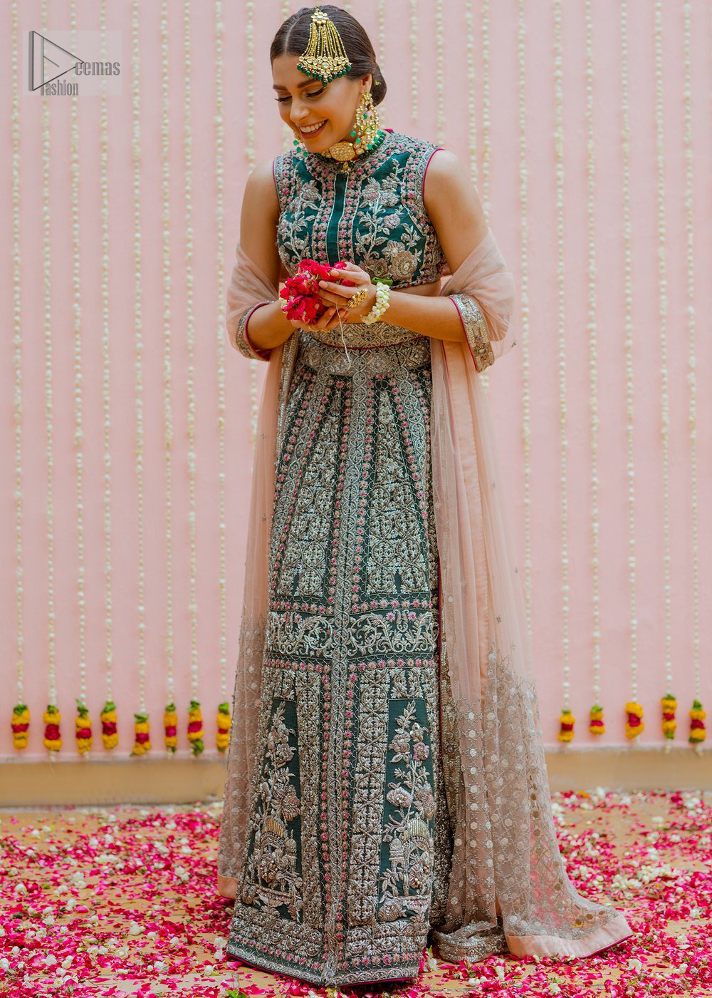 Bottle Green Velvet Blouse Lehenga Tan Dupatta. Blouse is beautifully decorated with multiple color floral embroidery.