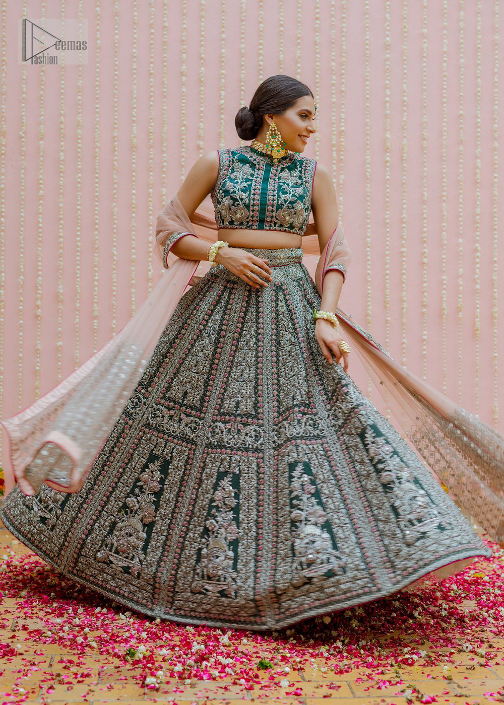 Bottle Green Velvet Blouse Lehenga Tan Dupatta. This dress is beautifully sculptured with floral embroidery, adorned with silver kora, dabka, pearl and sequins work all over.