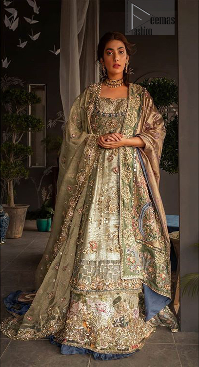 This dress is perfect for your special day. This signature pishwas is crafted with organza featuring hand embroidery with elegant zardosi work. The bottom of the pishwas is enhanced with multiple color rich floral embroidery. The lehenga is timeless and elegant with a touch of modern trend,includes embroidery of kora, dabka, sequins and large floral motifs made up with multiple color resham threads. The dupatta incorporates beautifully designed borders on all four sides, focusing on the heavily embellished pallu borders to give it a perfect maharani look.