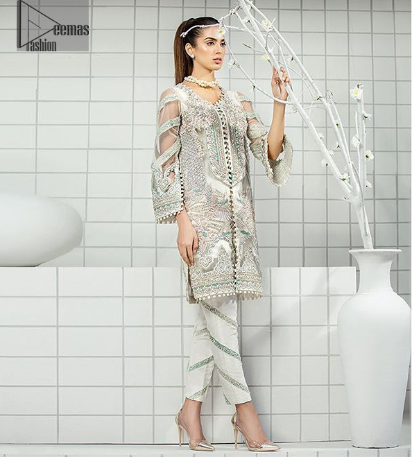 This formal wear dress is majestic beauty. Delicately crafted and personifying chic elegance with an element of grandiose. A full heavily embroidered front open shirt with silver zerdozi work details all over. The daaman is furthermore highlighted with embellished border. Having full length sleeves adorned with silver kora, dabka and tilla embroidery. Paired up with organza straight trouser decorated with embroidered lace. It comprises with chiffon dupatta having sprinkled sequins on the ground.