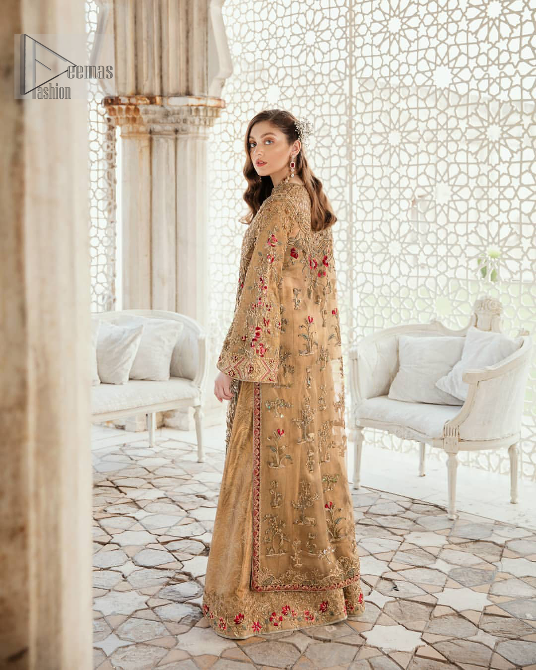This elegant ensemble turns timeless piece into a chic fantasy. Perfect for this festive season with divine detailing of thread embroidery, color balance and well-crafted zardosi work. Furthermore it is elevated by vibrant floral motifs and red embellished slits. It comprises with self printed sharara ornamented with captivating embellished bottom. Style it up with matching organza dupatta with chann all over.