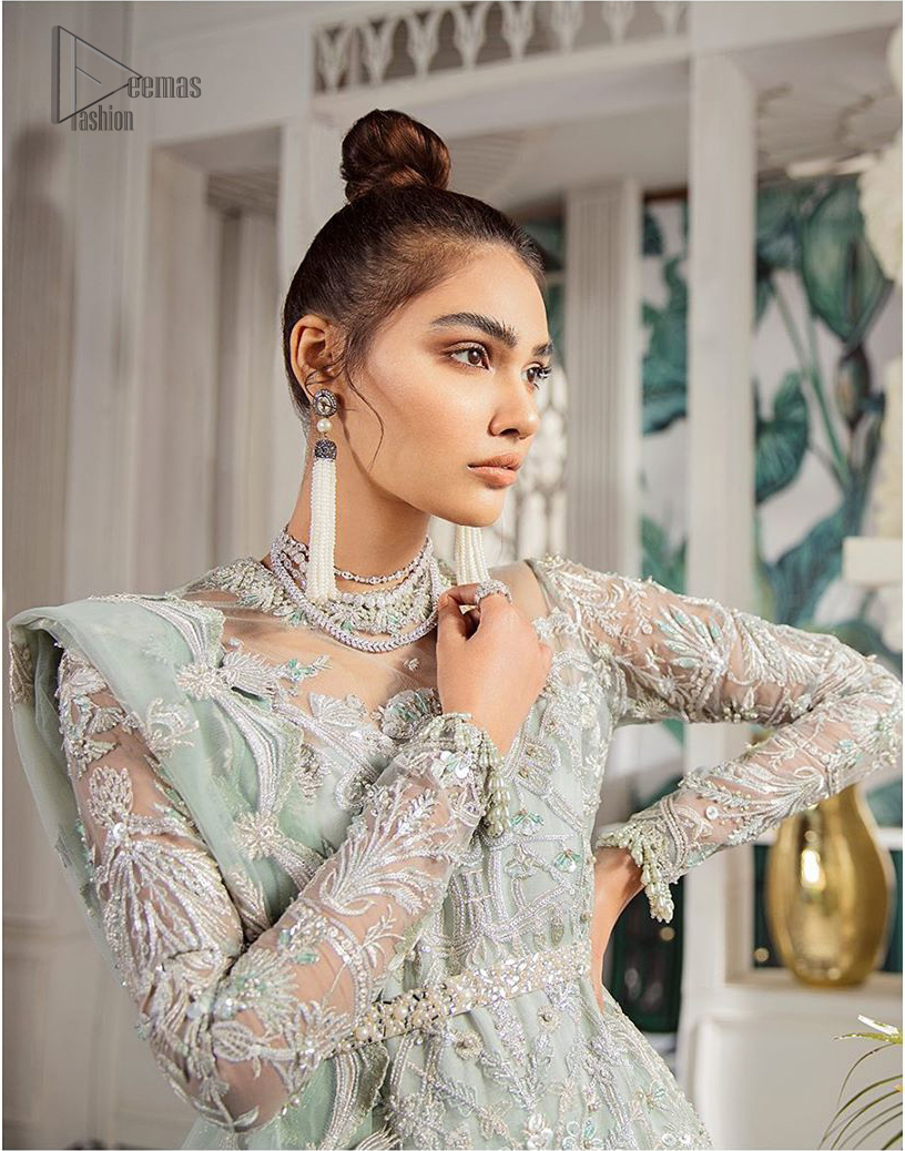 Delicately crafted and personifying chic elegance with an element of grandiose. This outfit is aesthetically designed with motifs and floral patterns, embellished with kora, dabka, nakshi, sequins, cutdana and  crystals. The detailed scalp border gives a perfect ending to this peplum. Beautifully designed sleeves is an amalgamation of floral design elements. Sharara comprises of sequins spray all over. The dupatta incorporates beautifully designed scalloped borders on all four sides and tiny floral motifs.