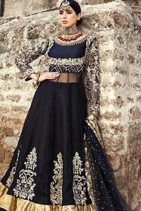 Delicately crafted and personifying chic elegance with an element of grandiose. This regal black outfit is an immensely captivating traditional piece, enhancing the art of classical heritage showcasing the craftsmanship of golden kora, dabka, tilla detailed with sequins and pearls; artistically embellished to give a beautiful rhythm to the outfit. Furthermore the anarkali frock is enhanced with fascinating embellishment on neckline and frilled hemline. It comes with an exquisite black lehenga with thick embroidered bottom to give it a regal look. It comes with a black net dupatta with sequins sprayed all over finished with thick embellishment all around the edges.