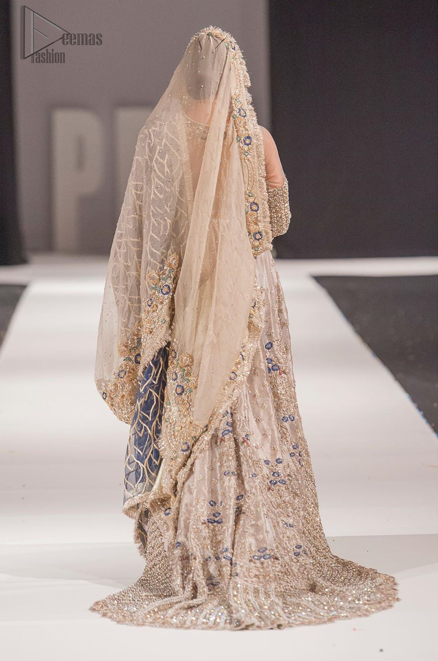 This artisan piece includes intricate hand-embellishment. This technique gives your garments a unique look, and helps to sustain a traditional craft carried out by skilled artisans across Asia. Adorned with dull golden zardozi and multiple color thread embroidery around the neckline and bodice. Furthermore the scalloped bottom is ornamented with floral jhaal, multiple color embellished floral bootis and tiny motif all over. Style it up with gray dupatta done with gotta work and cigarette pants.