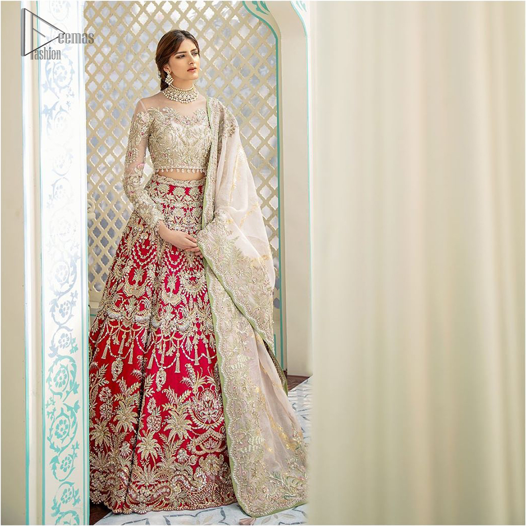 This elegant ensemble turns timeless piece into a chic fantasy. Best choice for your wedding day. This outfit is enhanced with hand embellishments on bodice and sleeves finishing with dangling tassels on the blouse. The lehenga is an amalgamation of a variety of our signature motifs, fine materials, and traditional yet contemporary silhouettes. Crafted from the prettiest zardozi work. Paired it up with off white self fabric dupatta having four sided embroidered border.