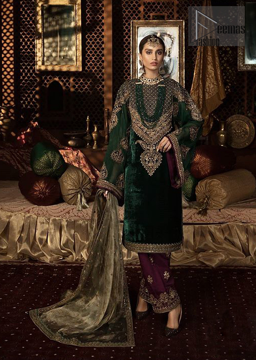 Let the crowd stare and make it worth their while when you walk wearing this beautiful outfit. The shirt carries intricate zardozi embroidery in antique and dark antique shades. Upholding the idea of simple is beautiful, you would definitely want to wear this for your next occasion. Complement the look with plum trousers enhanced with embroidered border in shades ofantique. Style it up with olive green dupatta sprinkled with sequins and four sided embroidered borders.
