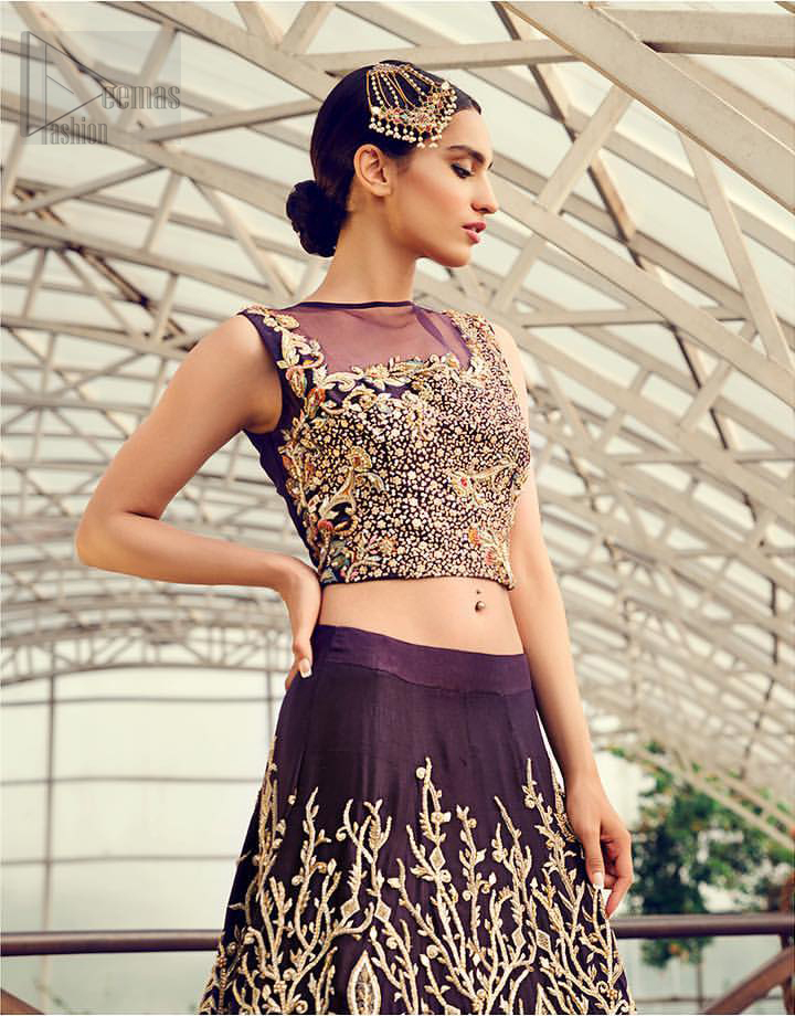 Captured in traditional silhouette, The bridal stands out due to its uniqueness and the perfect fusion of modern cut and traditional embroidery. This dress is beautifully decorated with heavy embroidery. It is highlighted with light golden kora, dabka, tilla, sequins and pearls. Blouse is fully enhanced with zardosi work and multiple color embroidery. It comes with full embellished lehenga adorned with floral booties and heavy embellished bottom. It is coordinated with plum organza dupatta which is sprinkled with sequins all over it.