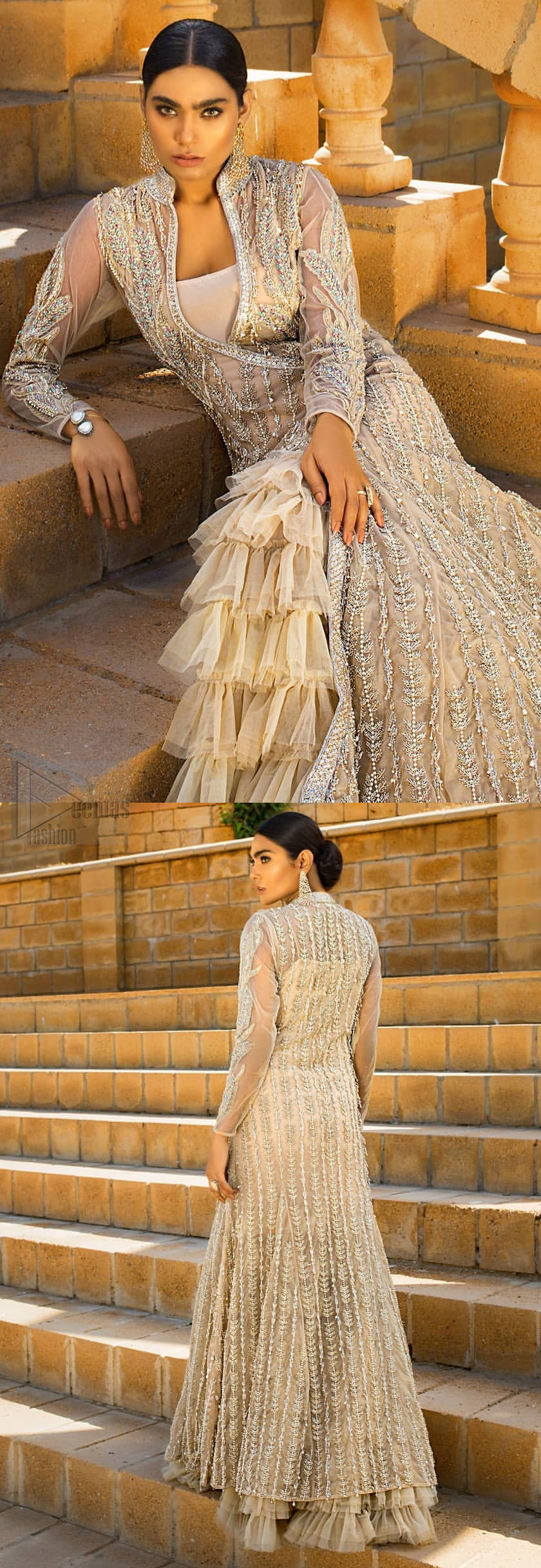 A fusion of traditional and latest fashion making the outfit trendy and unique. This angrakha style floor length maxi is heavily hand crafted with floral embroidery on the bodice, floral booties and vertical lines all over the dress. Back is also enhanced with vertically designed floral booties and swarovski crystals lines all over. The embroidery is done in the shades of silver and dull golden zardozi work. Style it up with frilled lehenga to give it a regal look. This outfit is comprises with fawn net lehenga sprinkled with sequins spray all over.