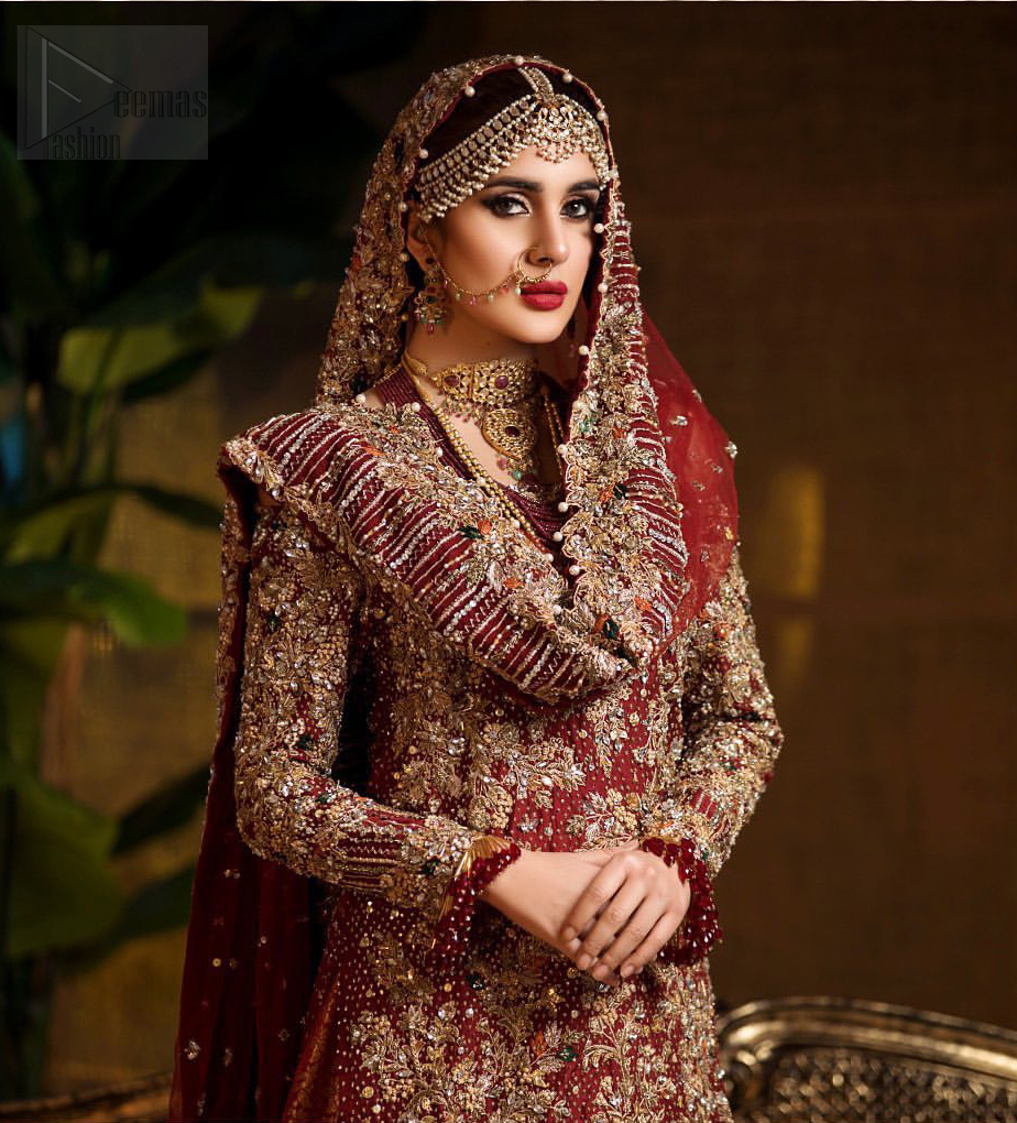 Captured in traditional silhouette. The bridal stands out due to its uniqueness and the perfect fusion of modern cut and traditional embroidery. This dress is beautifully highlighted with zardozi work in the shades of tan and silver. The hemline of the shirt is adorned with scalloped finishing and tassels on the sleeves. It comes with katan banarsi gharara with wide flare decorated with kora, dabka, tilla and pearls work. It is coordinated with organza dupatta which is sprinkled with sequins all over it. It is further furnished with four sided scalloped border.