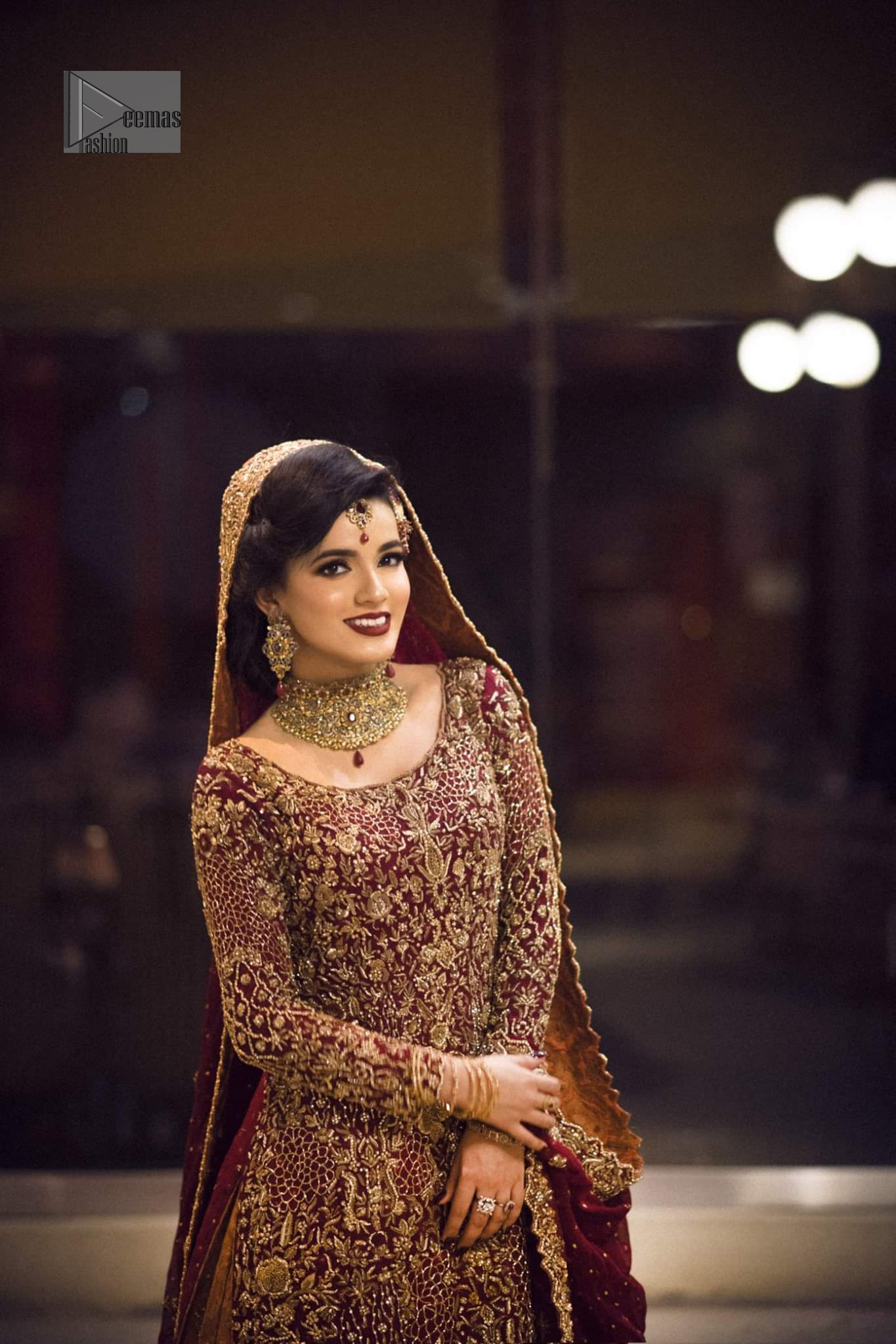 Pakistani Reception Wear - Maroon Shirt – Rust and Maroon Lehenga. You are all set to make a lasting impact with the divine royalty of this dress. This ravishing ensemble is sure to make you look like glamorous royalty with immaculate work covering every inch of the shirt. It boasts a pretty scallop hemline and full sleeves with zardozi embellishment. Compliment the look with flared lehenga. The combination of rust with maroon is absolutely breathtaking. Elegance is personified when it gets paired up with an all-over sequins spray-on dupatta with alternating scalloped borders detailing. This is an ensemble that deserves to be flaunted.