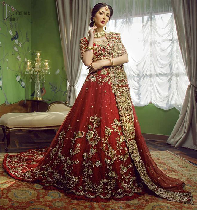 This signature Blouse and lehenga crafted with Velvet featuring hand embroidery with elegant zardozi work. Modern yet traditional.