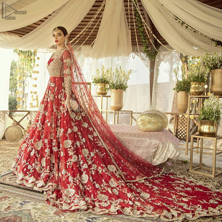Pakistani Bridal Wear - Red Front Open Back Train Maxi. Complete the look with an artfully coordinated maxi which is ornamented with a bold and captivating back trail design with a traditional intricately embroidered.