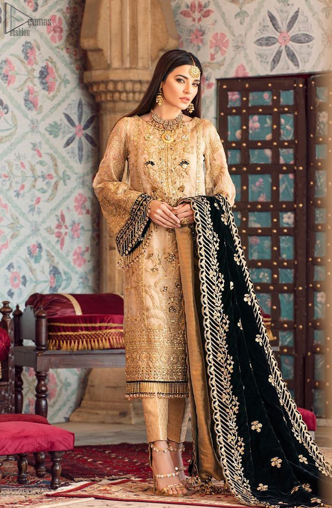 The beige pure organza shirt has been appliqued with black velvet on cuffs and on the hemline. This straight shirt comes with pure banarsi jamawar cigarette Pants. Dupatta is like a shawl in velvet a perfect combination for Nikah n Engagement.
