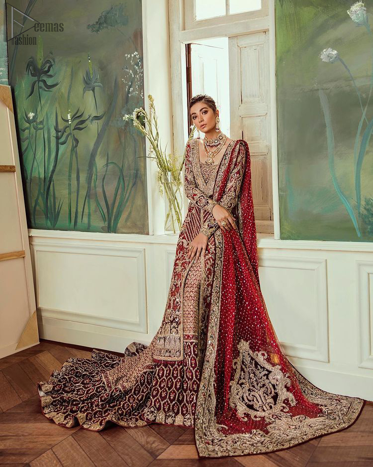 Deep red jacket gown having inner velvet blouse with maroon back train lehenga and heavily embroidered dupatta.