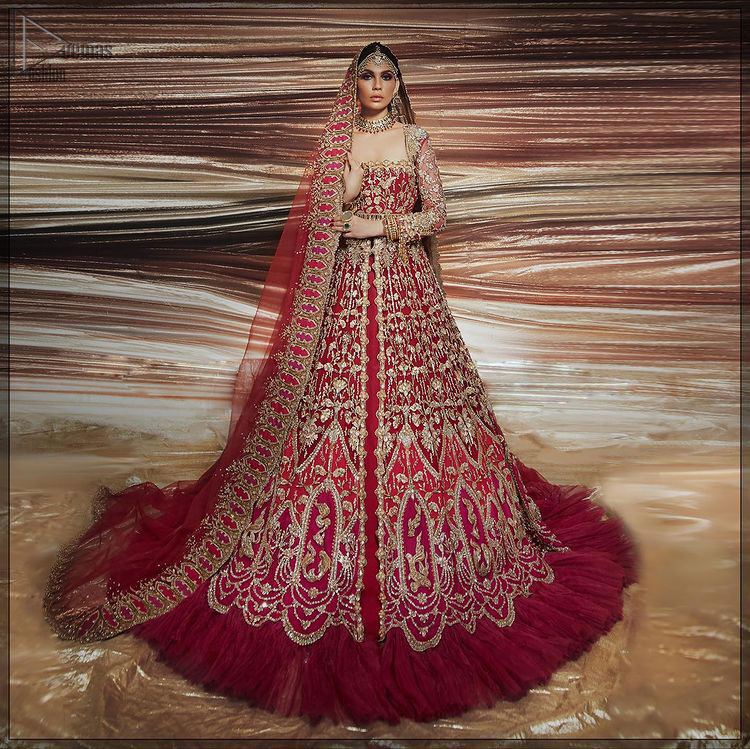 A bride wants to feel as beautiful as she is on her special day, and knowing that our Lehenga was the final decision in that, it is priceless. This bold and iconic bridal ensemble with its dainty flutter silhouette leaves us feeling whimsical, romantic, and even a bit enchanted. This front open pishwas is laden with silver and golden zardozi work, a beautifully crafted waist belt and floral embroidery patterns. The dress is even more enhanced with the ruffled bottom. It is coordinated with a beautiful dupatta with thick matha Patti borders along the length and an intricate beautiful border on the rest of the two sides.